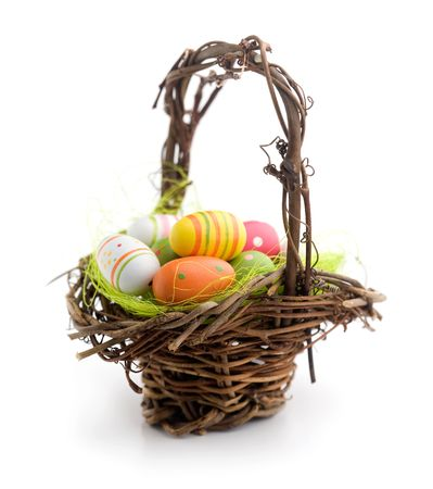 Colorful painted easter eggs in brown basket Stock Photo - 7745328