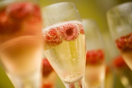 Champagne in glasses with fresh red raspberries photo