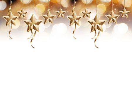Golden and shiny stars on white isolated background photo