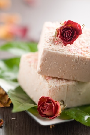 Pink bar of soap with dried roses photo