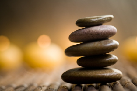 zen candles: Brown stones with water drops and flower petals