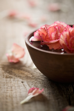 wooden aromatherapy: Close up of flowers floating in bowl of water