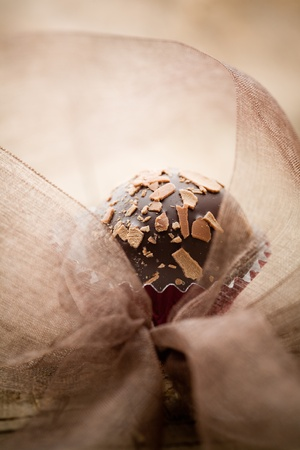 Close up of chocolate pralines with shallow focus photo
