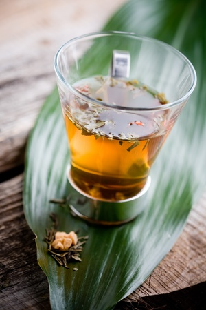 traditional plants: Cup of chinese green tea in glass Stock Photo