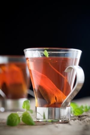 Cup of hot tea with fresh mint leaves photo