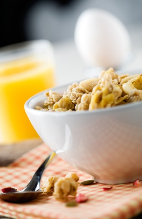 Breakfast with muesli, boiled egg and orange juice