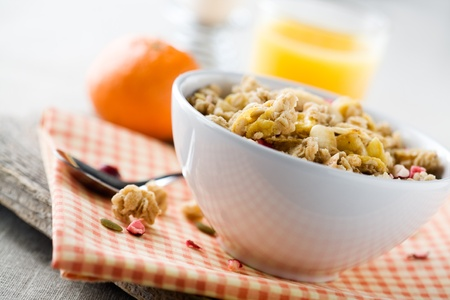 grain and cereal products: Breakfast with fresh muesli and orange juice Stock Photo