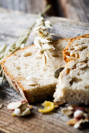 fresh slice of bread: Fresh homemade bread with oat and seeds Stock Photo