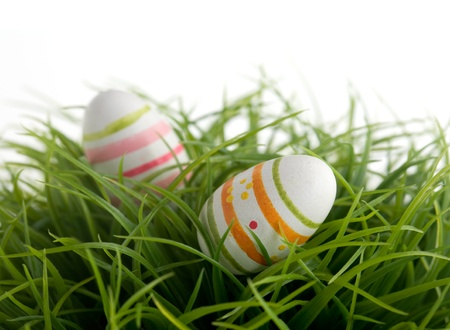 Colorful easter eggs on green grass, isolated on white Stock Photo - 8968795