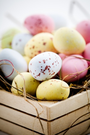 Chocolate easter eggs in little wooden box photo
