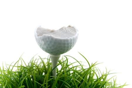 tee off: Golf ball on green grass, selective focus Stock Photo