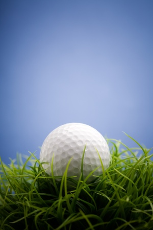 playing golf: Golf ball on green grass, selective focus Stock Photo
