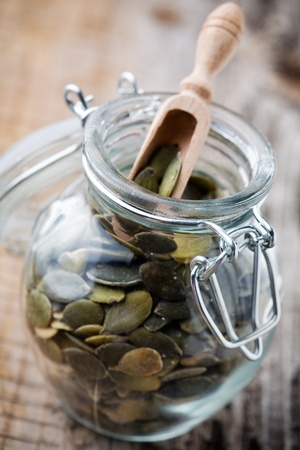 Close up of pumpkin seeds in glass jar photo