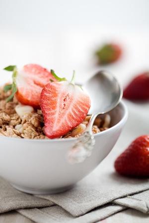 Breakfast muesli with fresh and sliced strawberries photo