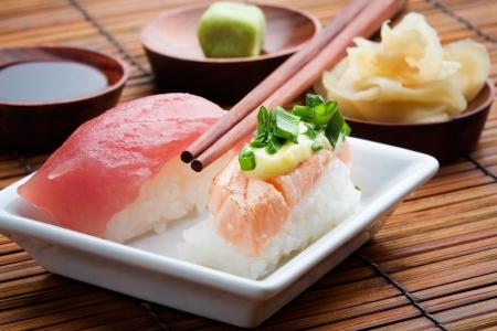 Nigiri sushi on white plate, selective focus photo