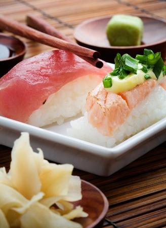 Nigiri sushi on white plate, selective focus