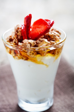 Breakfast with natural yogurt, muesli and honey photo