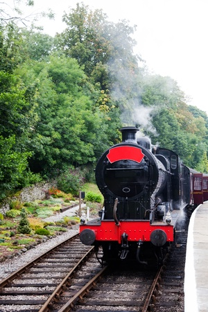 Old steam train waiting on the platform photo