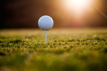 Golf ball on white tee, selective focus Stock Photo