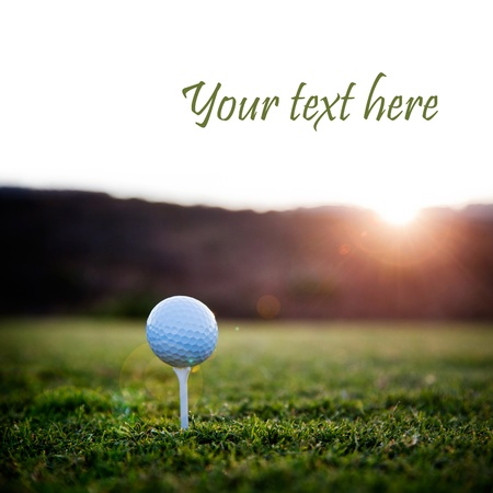 golf: Golf ball on white tee, selective focus Stock Photo