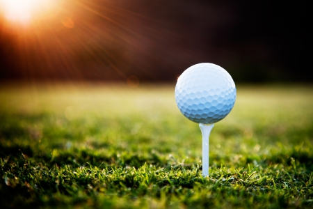 golf field: Close up of golf ball on tee  Stock Photo
