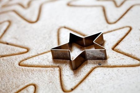 Baking star shape christmas cookies, selective focus Stock Photo - 10708147