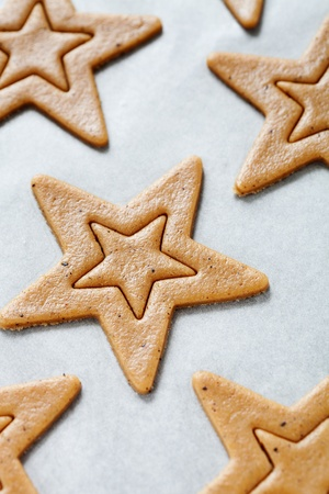 pastry cutter: Baking star shape christmas cookies, selective focus
