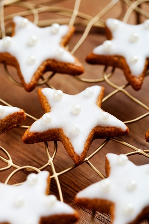 Baking star shape christmas cookies, selective focus photo