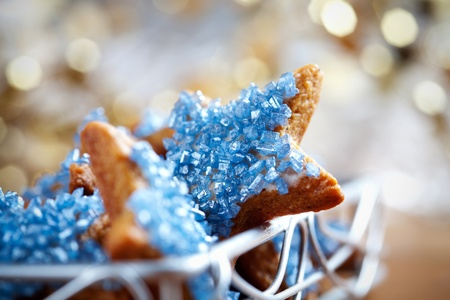 biscuit dough: Star shape christmas cookies with blue decorations