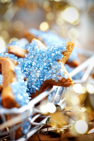 wood cutter: Star shape christmas cookies with blue decorations
