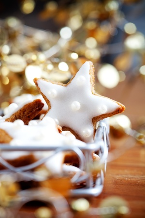 Star shape christmas cookies with blue decorations