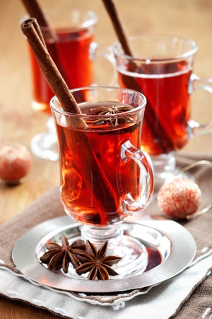 Mulled wine with cinnamon sticks and gingerbread cookies photo