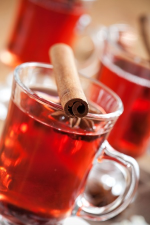 Close up of mulled wine glass with cinnamon stick photo