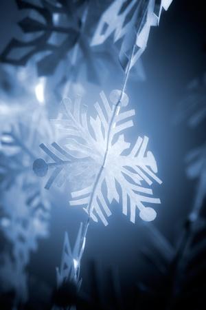 Beautiful handmade paper snowflake hanging, selective focus