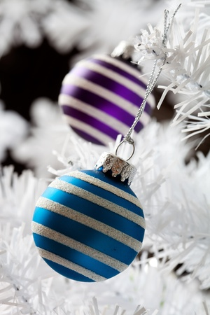 Colourful christmas baubles hanging from white christmas tree Stock Photo - 10816978