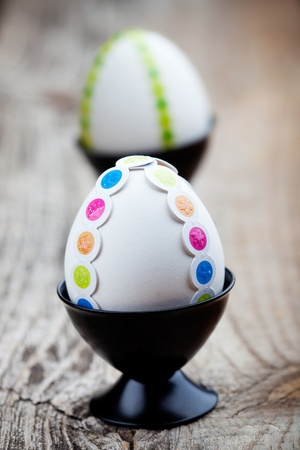 White easter eggs decorated with colorful stickers Stock Photo - 12594323