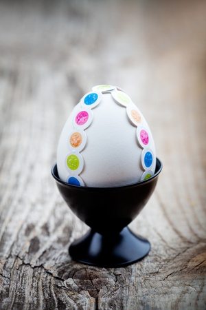 White easter eggs decorated with colorful stickers Stock Photo - 12594339