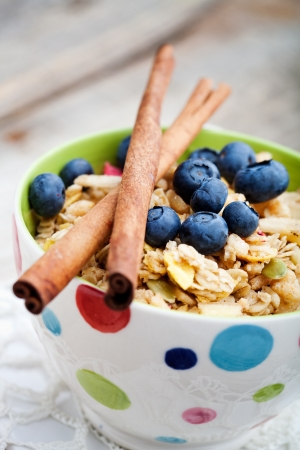 Breakfast muesli with dried fruits and seeds photo