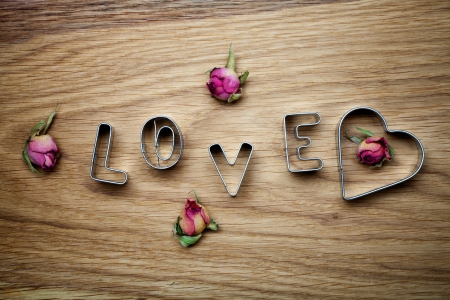 Letters of love cookie cutters with dried roses photo