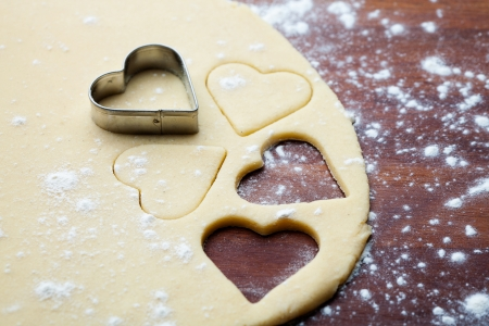 Baking heart shape cookies for Valentine´s Day photo