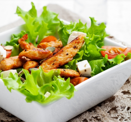 Healthy salad with roasted chicken, tomatoes and feta photo