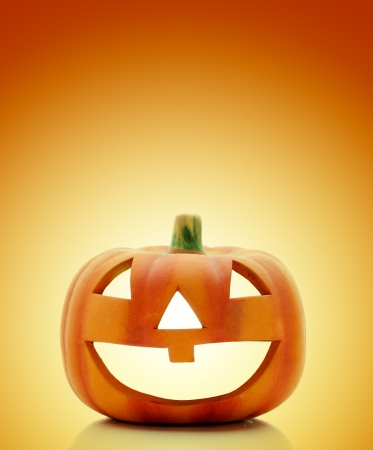 Halloween lantern on orange background, selective focus Stock Photo - 15034625