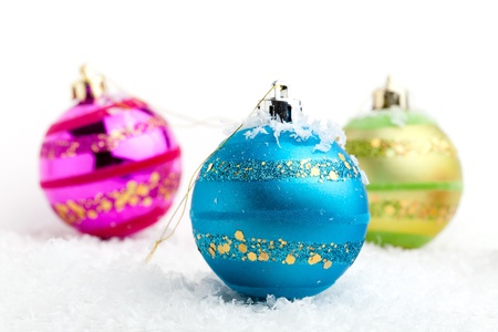 Colorful Christmas baubles on white isolated background photo