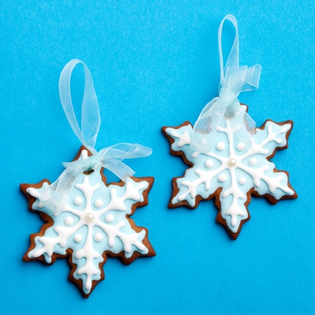 Gingerbread cookies decorated with light blue and white photo