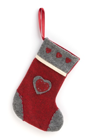 Handmade christmas stocking on white isolated background photo