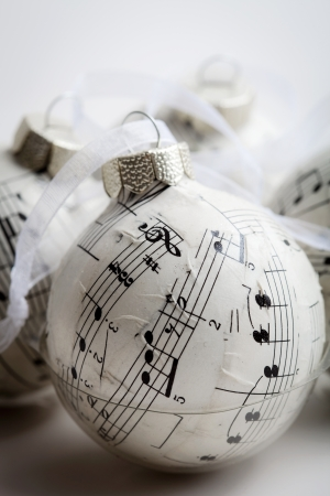 hang up: Christmas baubles made from old music book