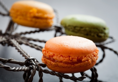 Fresh homemade macaroons in three beautiful colors photo
