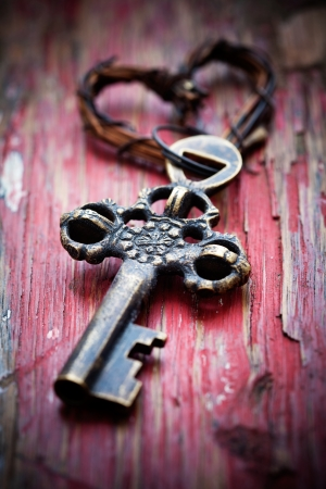 Old key with heart keyholder, selective focus