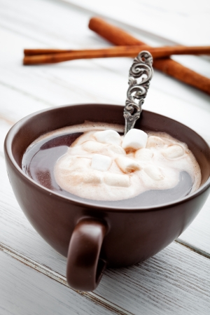 Hot chocolate with white marsmallows, selective focus photo