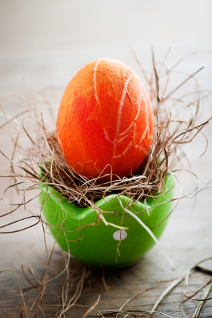 Bright orange easter eggs with selective focus photo